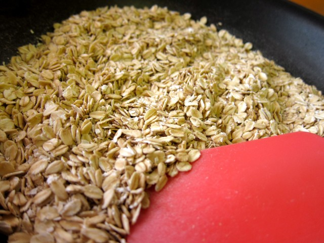 Stirring toasting oats