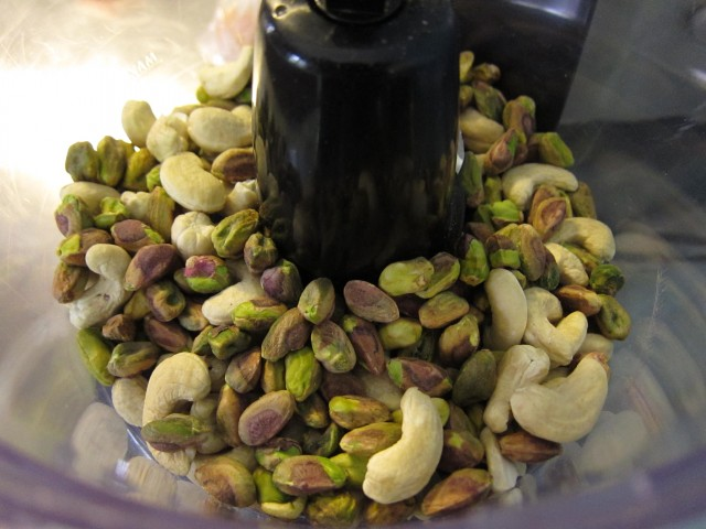 Pistachios and cashews in processor
