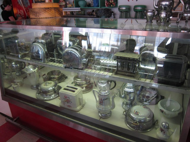 Old toasters in glass case