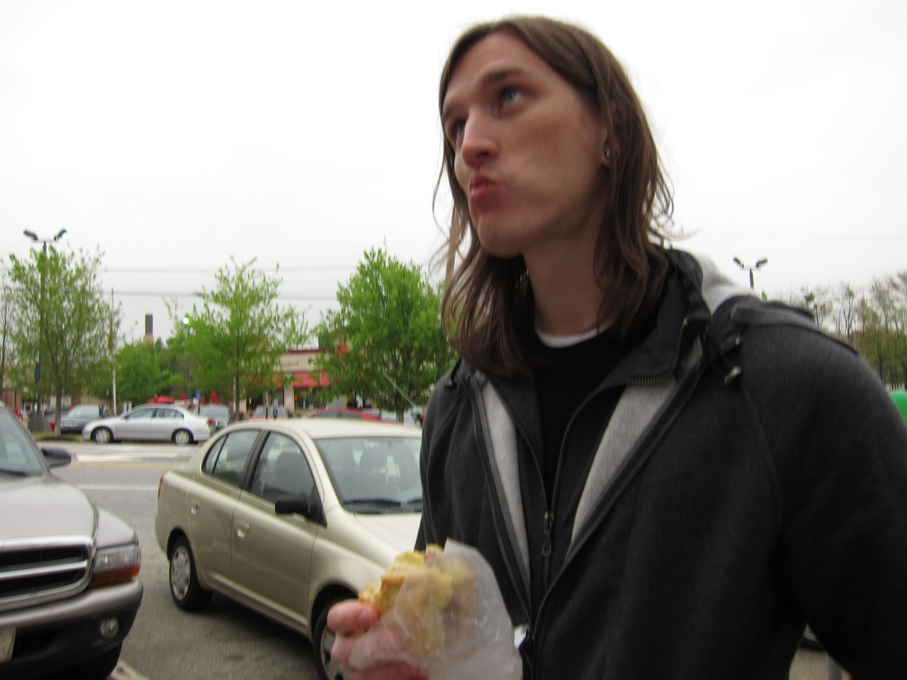 Jeff eating a sausage biscuit