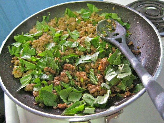 Adding thai basil to pork