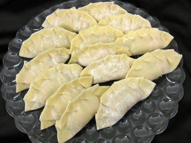 Plate of uncooked potstickers