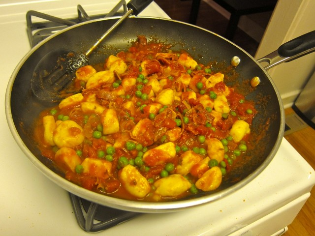 toss gnocchi and peas in the sauce