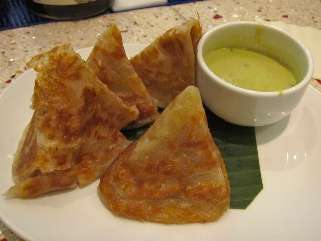 Roti with green curry sauce