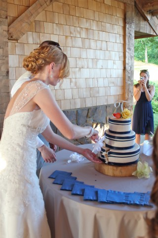 Bryan and Caitlin cutting the cake