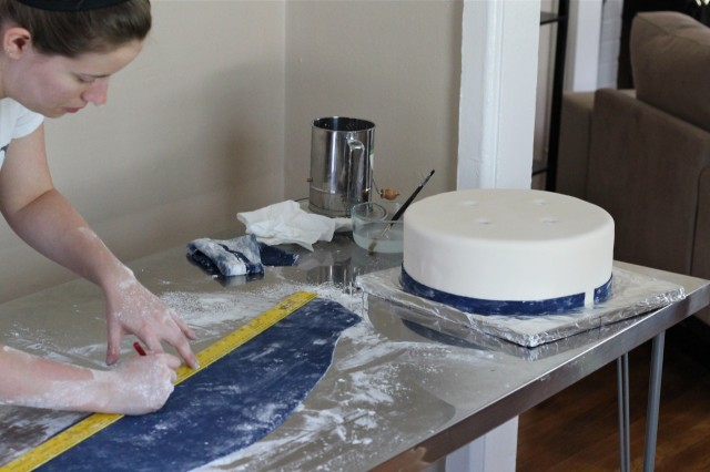 Measuring a strip of fondant